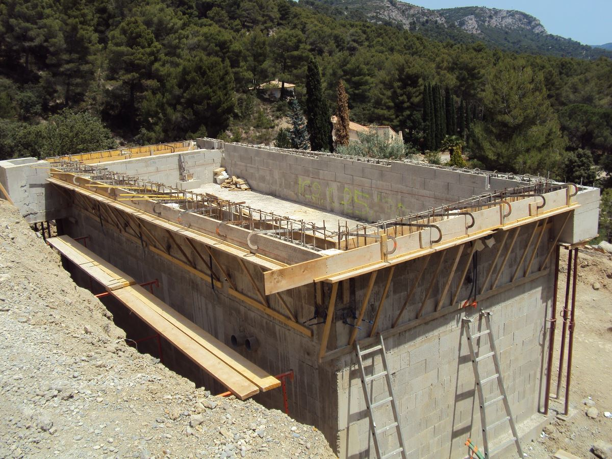 D co piscine debordement construction fort de france for Construction piscine debordement